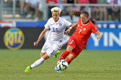 Megan Rapinoe of the US women's national team and Martina Moser of the Swiss women's national team battle for the ball during their match at WakeMed...