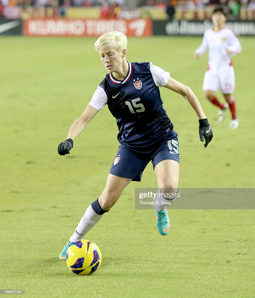 Megan Rapinoe #15 of the U.S. Women's National Team dribbles the ball against the China Women's National Team in an international friendly game at BBVA Compass Stadium on December 12, 2012 in Houston, Texas. USA won 4 to 0.