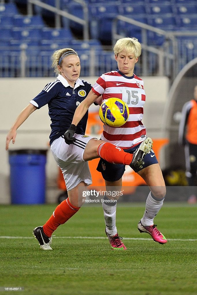 <a gi-track='captionPersonalityLinkClicked' href=/galleries/search?phrase=Megan+Rapinoe&family=editorial&specificpeople=736784 ng-click='$event.stopPropagation()'>Megan Rapinoe</a> #15 of the U.S. Women's National Team plays against Rachael Small #3 of the Scotland Women's National Team at LP Field on February 13, 2013 in Nashville, Tennessee.
