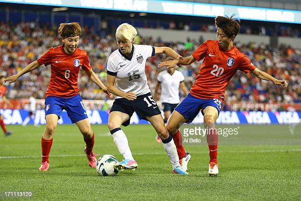 Megan Rapinoe of the USA in action against Lim Seonjoo and Kim Hyeri of Korea Republic during their game at Red Bull Arena on June 20 2013 in...
