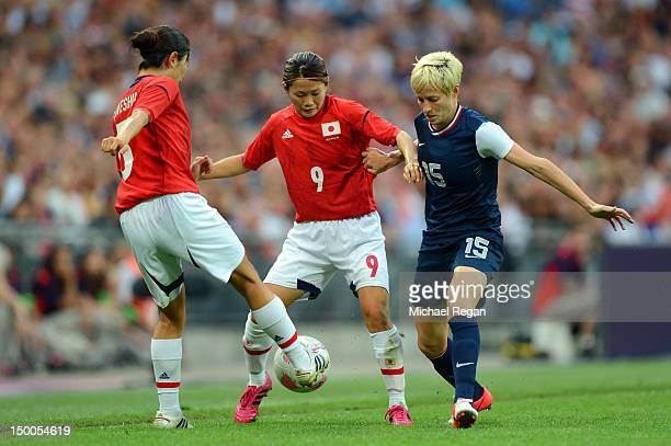 Megan Rapinoe of United States fights for the ball against Aya Sameshima and Nahomi Kawasumi of Japan during the Women's Football gold medal match on...