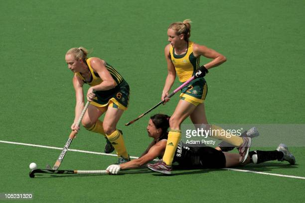 Megan Rivers and Fiona Boyce of Australia battle for the ball with Kayla Sharland of New Zealand during the women's finals gold medal match between...
