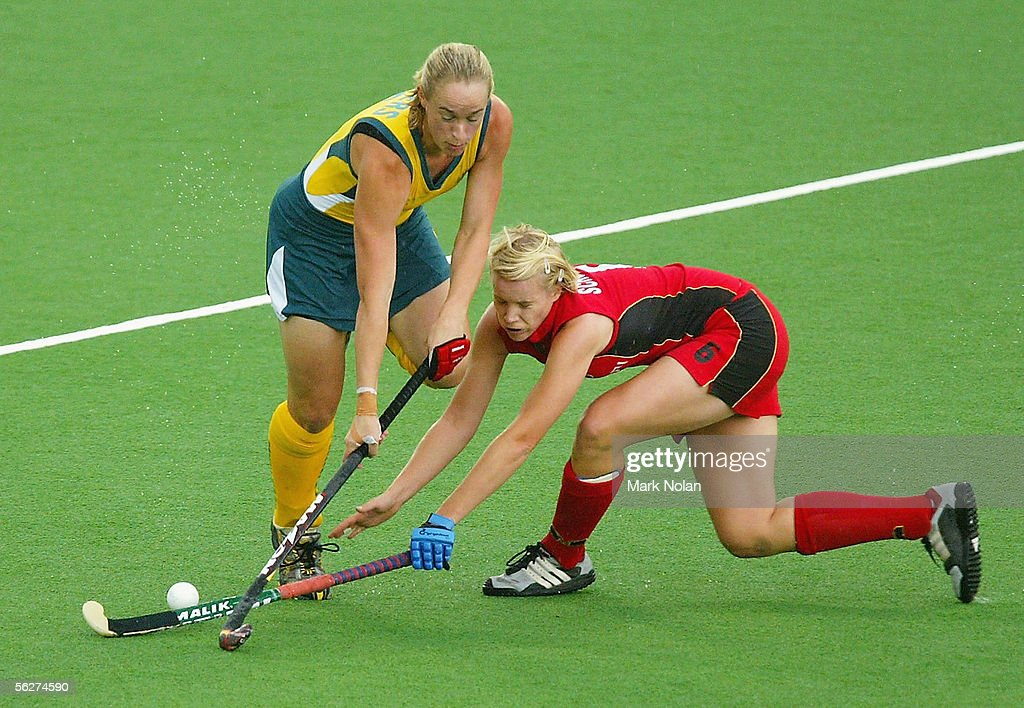 Megan Rivers of Australia and Svenja Schuermann of Germany in action during the Women's Hockey Champions Trophy first round match between Australia...