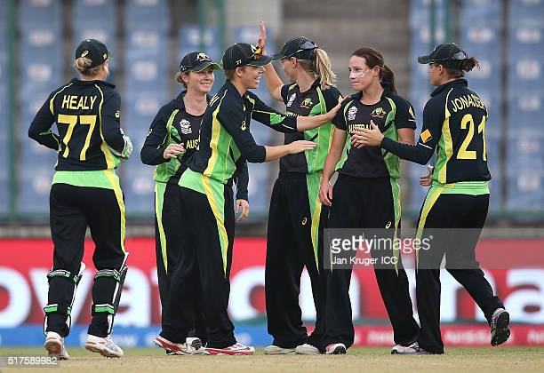 Megan Schutt of Australia celebrates the wicket of Clare Shillington of Ireland wit team mates during the Women's ICC World Twenty20 India 2016 match...