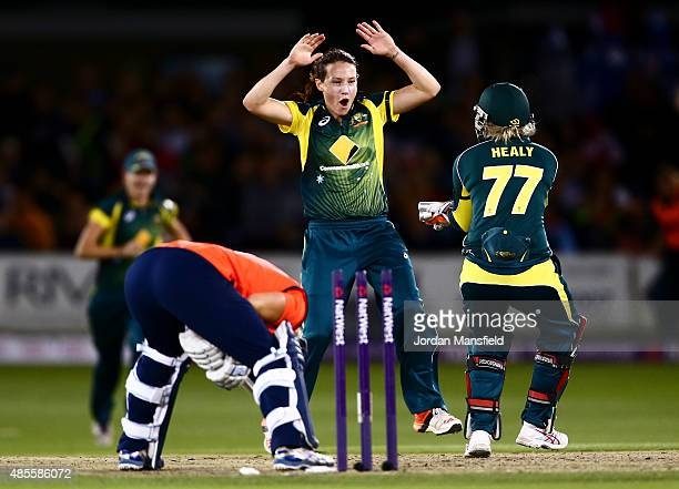 Megan Schutt of Australia celebrates with Alyssa Healy of Australia after bowling out Katherine Brunt of England during the 2nd NatWest T20 of the...