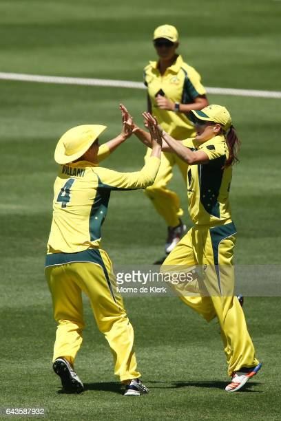 Megan Schutt of Australia celebrates with teammates after she took a catch to dismiss Amy Satterthwaite of New Zealand during the Women's Twenty20...