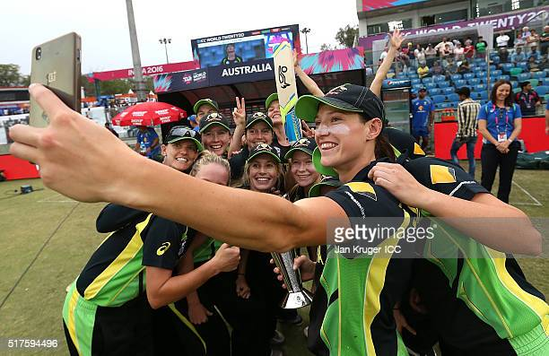 Megan Schutt of Australia takes a selfie with team mates during the Women's ICC World Twenty20 India 2016 match between Australia and Ireland at The...