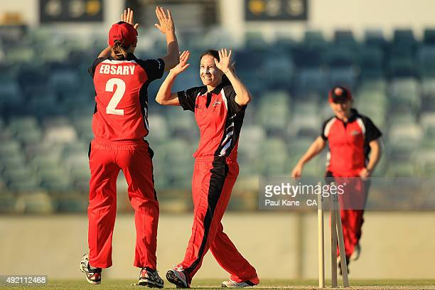 Megan Schutt of South Australia celebrates after the runout of Rene Farrell of New South Wales and winning the round one WNCL match between New South...