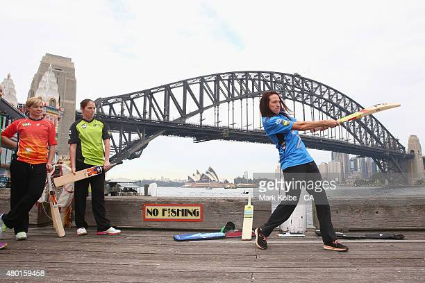 Megan Schutt of the Adelaide Strikers hits a ball at a giant set of stumps on a barge in the harbour during the Women's Big Bash League season launch...