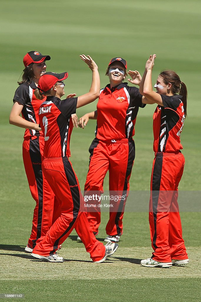 Megan Schutt (R) of the Scorpions celebrates with team mates after bowling out Alex Blackwell of the Breakers during the women's twenty20 match between the South Australia Scorpions and the New South Wales Breakers at Adelaide Oval on December 23, 2012 in Adelaide, Australia.