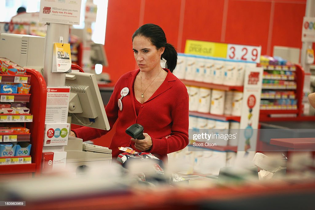 Megan Shore rings up a customer's merchandise at a Target store on October 10, 2013 in Chicago, Illinois. The store, which opened on October 8, was built on land where the notorious Cabrini-Green housing project once stood. The last of the Cabrini-Green high-rise homes were demolished two years ago. The housing project has been replaced with townhomes and retail shops, with some of the property being left vacant.