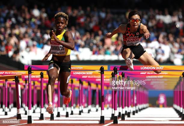 Megan Simmonds of Jamaica and Ayako Kimura of Japan compete in the Women's 100 metres hurdles heats during day eight of the 16th IAAF World Athletics...