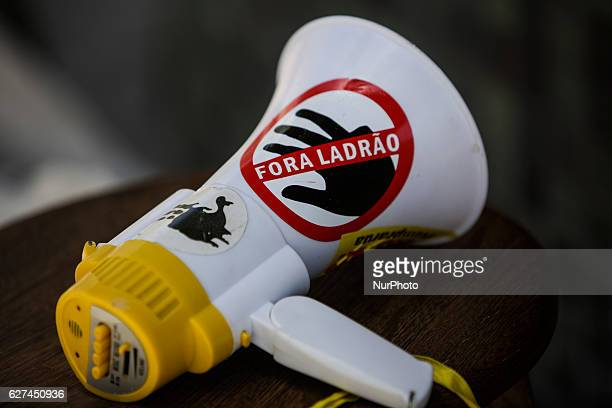A megaphone is seen with the phrase in Portuguese Away Thief Members of the popular Somos Mais Brasil movement protest against corruption in the...