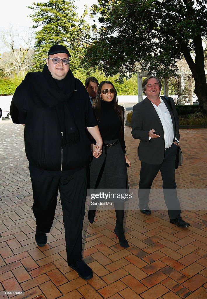Megaupload founder <a gi-track='captionPersonalityLinkClicked' href=/galleries/search?phrase=Kim+Dotcom&family=editorial&specificpeople=8806663 ng-click='$event.stopPropagation()'>Kim Dotcom</a> and his wife Mona arrive at Auckland High Court on August 7, 2012 in Auckland, New Zealand. Dotcom's re-appears for a judicial review of an earlier ruling that the US government has to grant Dotcom and his co-accused access to the evidence it holds against them.