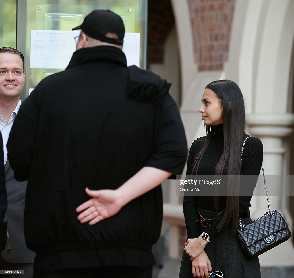 Megaupload founder <a gi-track='captionPersonalityLinkClicked' href=/galleries/search?phrase=Kim+Dotcom&family=editorial&specificpeople=8806663 ng-click='$event.stopPropagation()'>Kim Dotcom</a> (L) and his wife Mona wait at the Auckland High Court on August 7, 2012 in Auckland, New Zealand. Dotcom's re-appears for a judicial review of an earlier ruling that the US government has to grant Dotcom and his co-accused access to the evidence it holds against them.