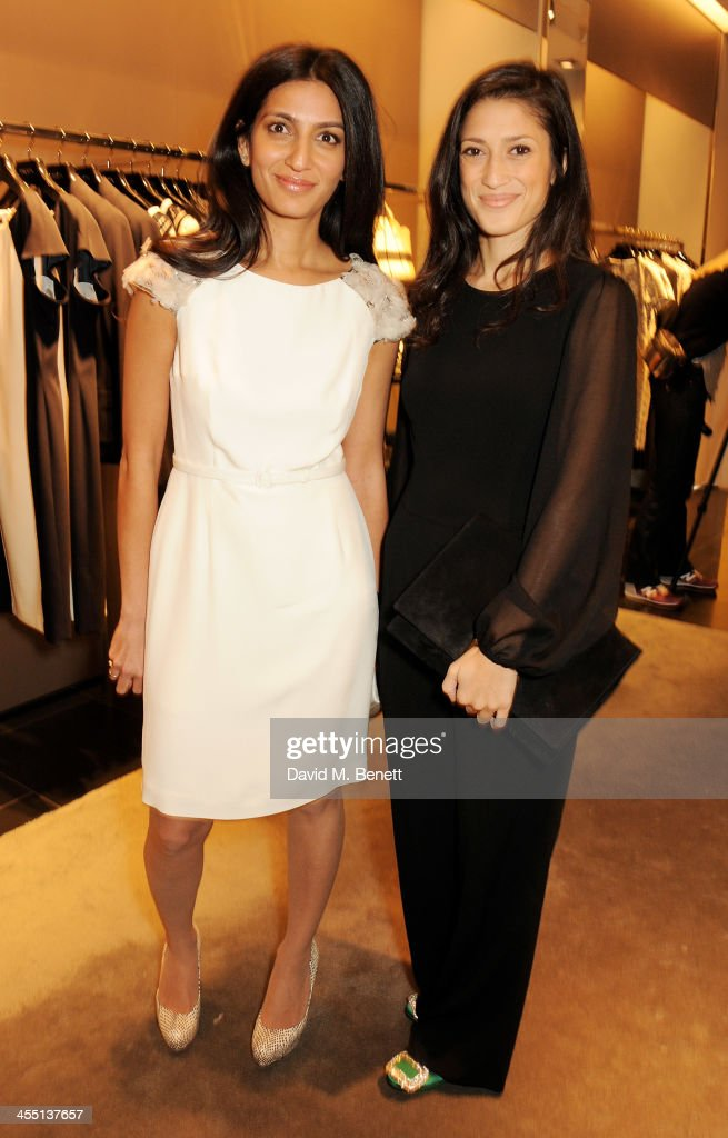 Megha Mittal (L) and Fatima Bhutto attend the ESCADA/Harper's Bazaar book reading with Fatima Bhutto, reading from her novel 'The Shadow Of The Crescent Moon', at the ESCADA Knightbridge boutique on December 11, 2013 in London, England.