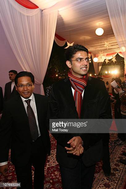 Meghalaya opposition leader Conrad Sangma with Sachin Pilot during the preChristmas party organized by the Sangma family at the official residence of...