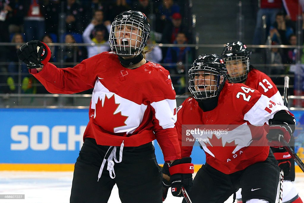 <a gi-track='captionPersonalityLinkClicked' href=/galleries/search?phrase=Meghan+Agosta-Marciano&family=editorial&specificpeople=10614941 ng-click='$event.stopPropagation()'>Meghan Agosta-Marciano</a> #2 of Canada celebrates after scoring a goal with Natalie Spooner #24 and Caroline Oullette #13 in the third period against the United States during the Women's Ice Hockey Preliminary Round Group A game on day five of the Sochi 2014 Winter Olympics at Shayba Arena on February 12, 2014 in Sochi, Russia.