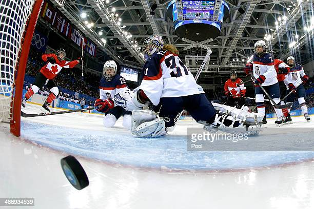 Meghan AgostaMarciano of Canada celebrates scoring a goal in the third period against Jessie Vetter of the United States during the Women's Ice...
