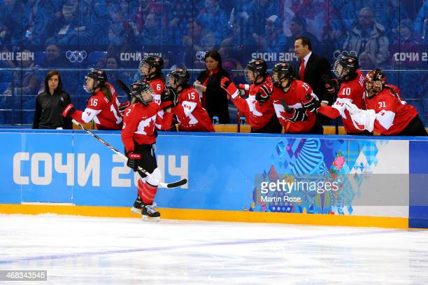 Meghan AgostaMarciano of Canada celebrates with her teammates after scoring a goal in the third period against Noora Raty of Finland during the...