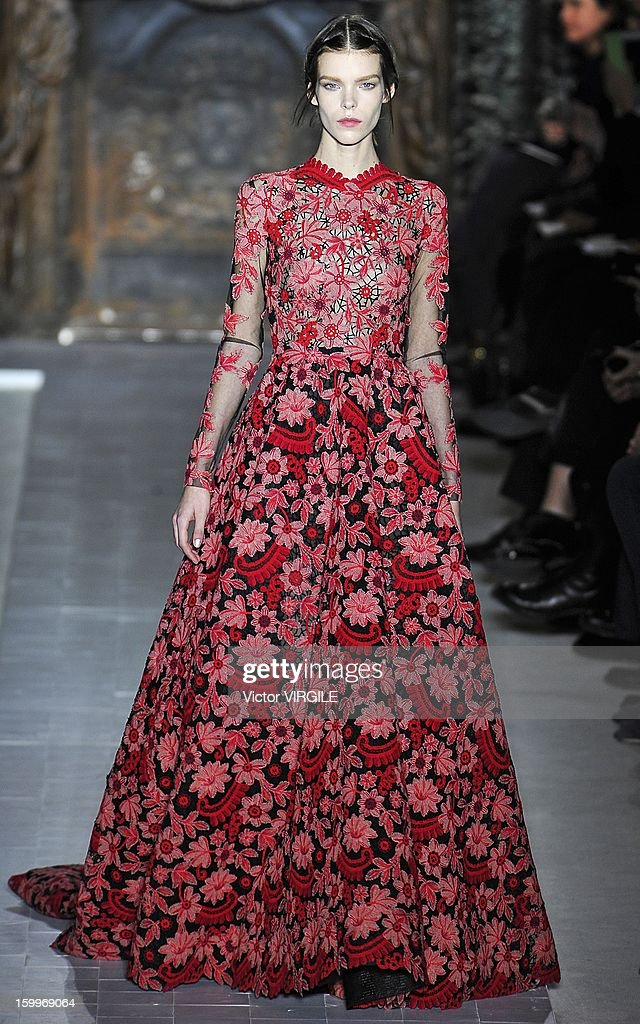 Meghan Collison walks the runway during the Valentino Spring/Summer 2013 Haute-Couture show as part of Paris Fashion Week at Hotel Salomon de Rothschild on January 23, 2013 in Paris, France.