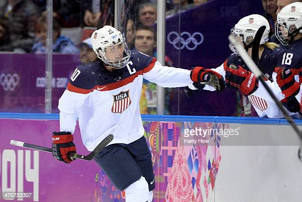 Meghan Duggan of the United States celebrates with teammates after scoring a secondperiod goal during the Ice Hockey Women's Gold Medal Game on day...