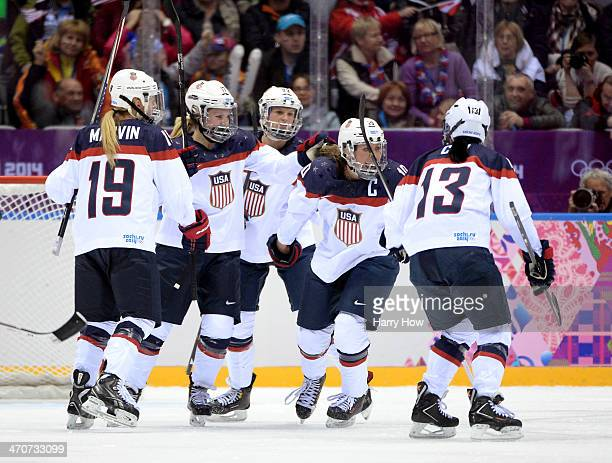 Meghan Duggan of the United States celebrates with teammates Julie Chu Kacey Bellamy Jocelyne Lamoureux and Gigi Marvin after scoring a secondperiod...