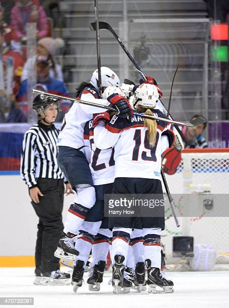 Meghan Duggan of the United States celebrates with teammates Julie Chu Kacey Bellamy and Gigi Marvin after scoring a secondperiod goal during the Ice...