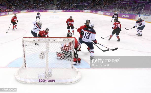 Meghan Duggan of the United States scores a goal against Shannon Szabados of Canada during the Ice Hockey Women's Gold Medal Game on day 13 of the...