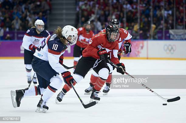 Meghan Duggan of United States and Meghan AgostaMarciano of Canada in action during the Ice Hockey Women's Gold Medal Game on day 13 of the Sochi...
