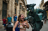 Meghan Hobbs Special Assistant to the Secretary of Agriculture and Forestry screams as she is playfully touched by a living statue in Old Havana...