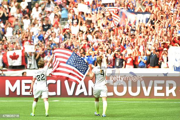 Meghan Klingenberg and Becky Sauerbrunn of the United States of America celebrate their 52 win over Japan in the FIFA Women's World Cup Canada 2015...