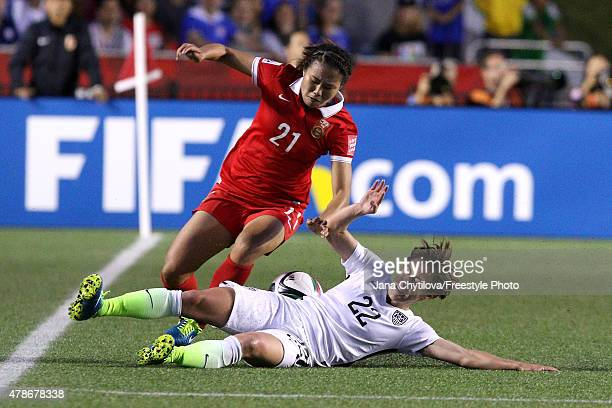 Meghan Klingenberg of the United States challenges Wang Lisi of China in the second half in the FIFA Women's World Cup 2015 Quarter Final match at...