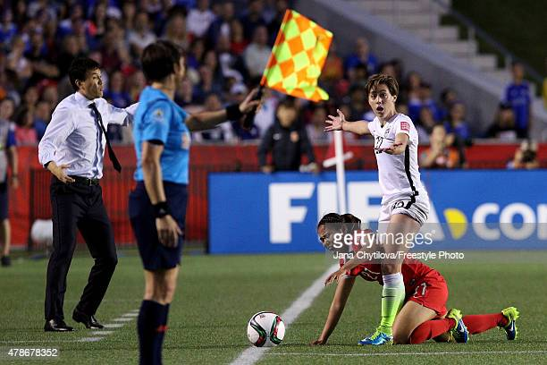 Meghan Klingenberg of the United States reacts after challenging Wang Lisi of China in the second half in the FIFA Women's World Cup 2015 Quarter...