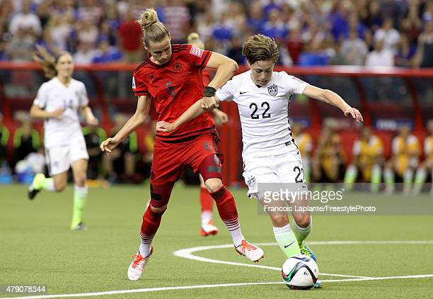 Meghan Klingenberg of the United States with the ball against Simone Laudehr of Germany in the second half in the FIFA Women's World Cup 2015...