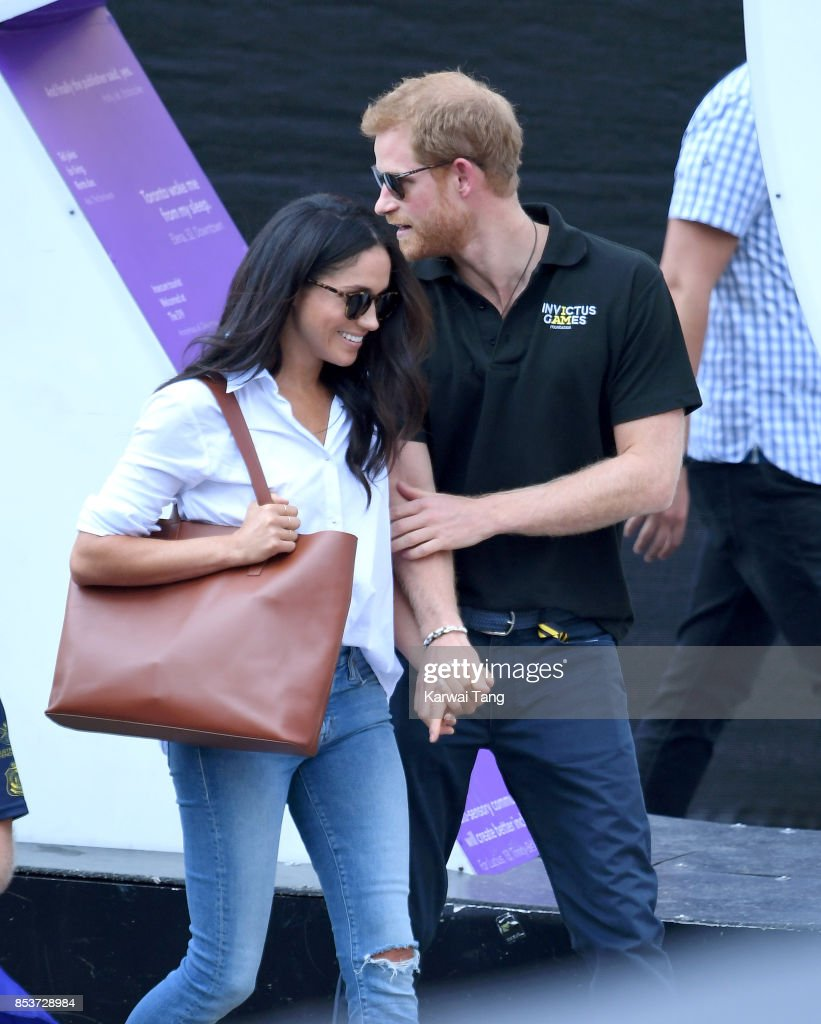 Meghan Markle and Prince Harry hold hands the Wheelchair Tennis on day 3 of the Invictus Games Toronto 2017 at Nathan Philips Square on September 25, 2017 in Toronto, Canada. The Games use the power of sport to inspire recovery, support rehabilitation and generate a wider understanding and respect for the Armed Forces.