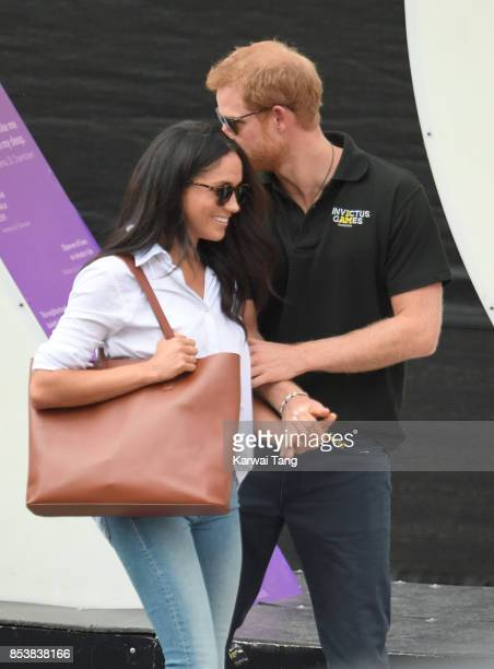 Meghan Markle and Prince Harry hold hands the Wheelchair Tennis on day 3 of the Invictus Games Toronto 2017 at Nathan Philips Square on September 25...