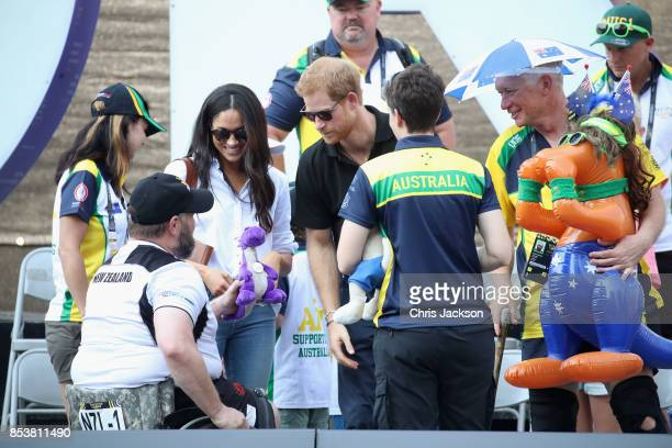 Meghan Markle and Prince Harry speak with a member of the public as she attends a Wheelchair Tennis match during the Invictus Games 2017 at Nathan...