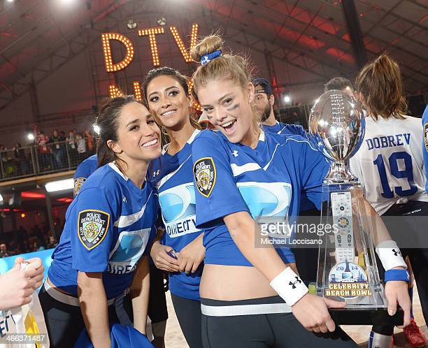 Meghan Markle Shay Mitchell and Nina Agdal participate in the DirecTV Beach Bowl at Pier 40 on February 1 2014 in New York City