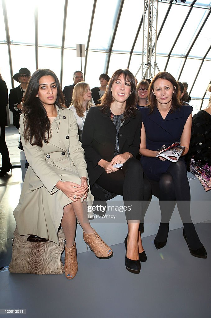 Meghan Mittal, <a gi-track='captionPersonalityLinkClicked' href=/galleries/search?phrase=Samantha+Cameron&family=editorial&specificpeople=624344 ng-click='$event.stopPropagation()'>Samantha Cameron</a> and Caroline Rush seen at the front row at the Acne runway show at London Fashion Week Spring/Summer 2012 at the Old Sorting Office on September 19, 2011 in London, England.