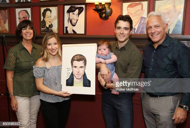 Meghan Woollard Elliott Michael Cott and Corey Cott and family during the Corey Cott Sardi's Portrait unveiling at Sardi's Restaurant on August 11...