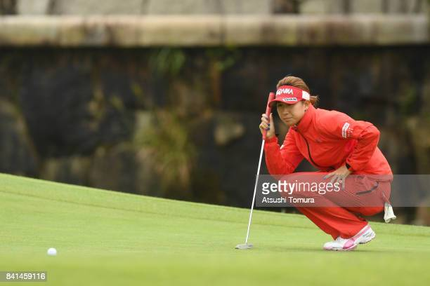 Megumi Kido of Japan lines up her putt on the 18th hole during the first round of the Golf 5 Ladies Tournament 2017 at the Golf 5 Country Oak Village...