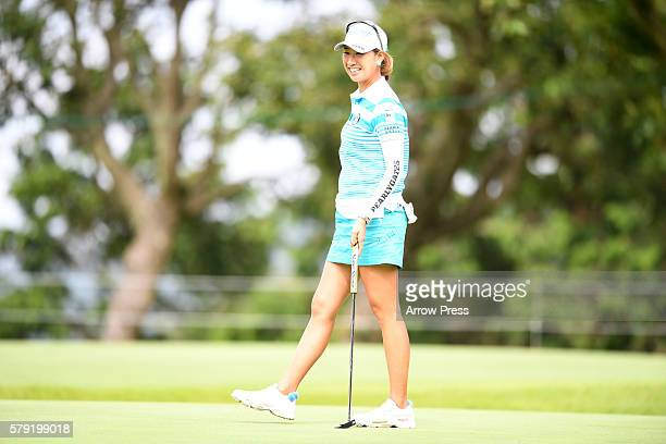 Megumi Kido of Japan smails during the second round of the Century 21 Ladies Golf Tournament 2016 at the Izu Daijin Country Club on July 23 2016 in...