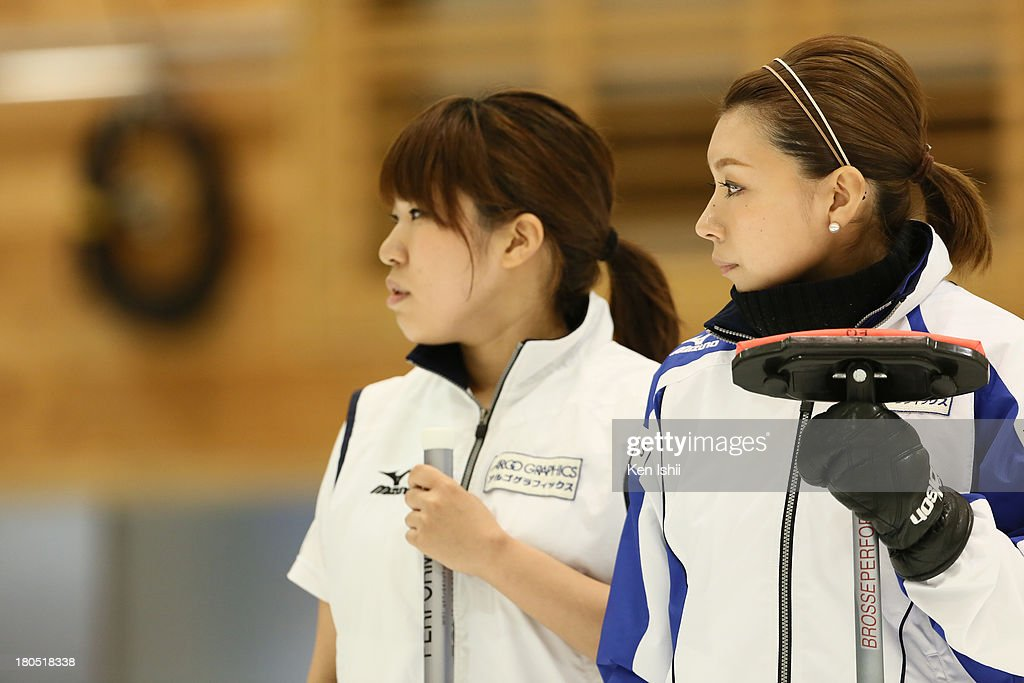 Megumi Mabuchi (L) and Mari Motohashi of LS Kitami look on during the last day of qualifier for the Curling Japan Qualifying Tournament at Dohgin Curling Stadium on September 14, 2013 in Sapporo, Japan.