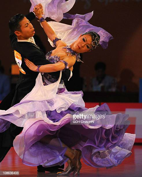 Megumi Morita and Minato Kojima of Japan compete in the dancesport standard tango event at the 16th Asian Games in Guangzhou on November 13 2010...