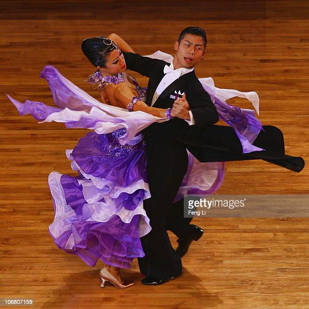 Megumi Morita and Minato Kojima of Japan compete in the the StandardTango of the Dance Sports at the Zengcheng Gymnasium during day one of the 16th...