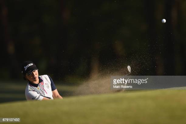 Megumi Shimokawa of Japan hits out of the 13th green bunker during the second round of the World Ladies Championship Salonpas Cup at the Ibaraki Golf...