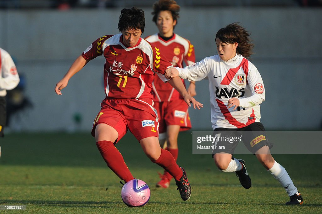 Megumi Takasa #11 of INAC Kobe Leonessa in action during the 34th Empress's Cup All Japan Women's Football Tournament semi final match between INAC Kobe Leonessa and Urawa Red Diamonds Ladies at Nack 5 Stadium Omiya on December 22, 2012 in Saitama, Japan.