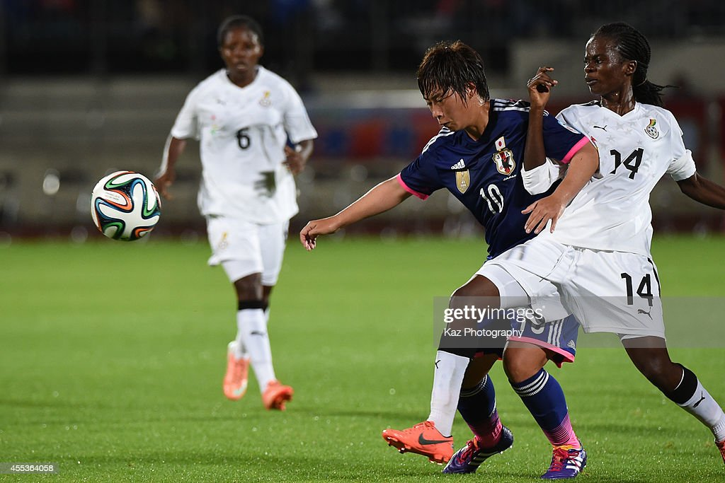 Megumi Takase of Japan keeps the ball under the pressure from Mercy Myles of Ghana during the women's international friendly match between Japan and...