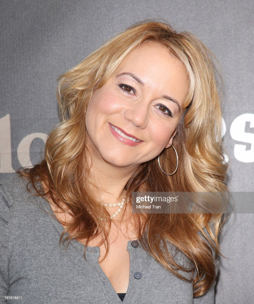Megyn Price arrives at The Los Angeles Modernism show & sale to benefit P.S. ARTS held at Barker Hangar on April 25, 2013 in Santa Monica, California.